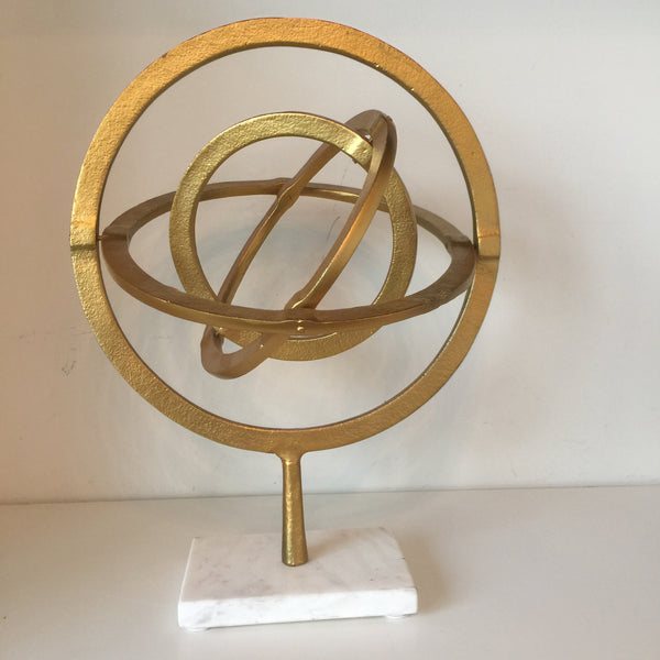 Golden Sphere on Marble Base