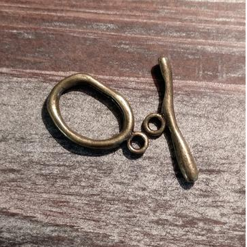 AB-910 - Antique Brass Pewter Wavy Oval Toggle,16x25mm | Pkg 5