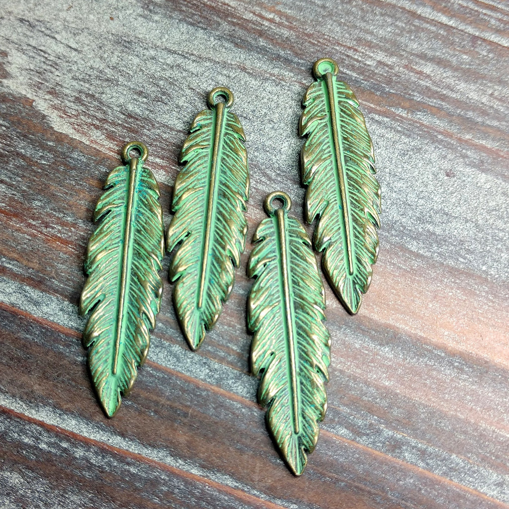 AB-0705 - Antique Brass With Green Patina Leaf Pendant, 12x40 | Pkg 4