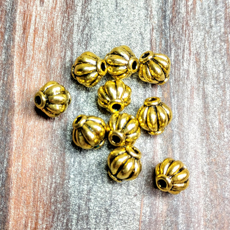 AB-0582 - Gold Metal Beads, Fluted, 7x8mm | Pkg 10