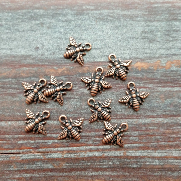 AB-7923 - Antique Copper Bee Charms, 11mm | Pkg 10
