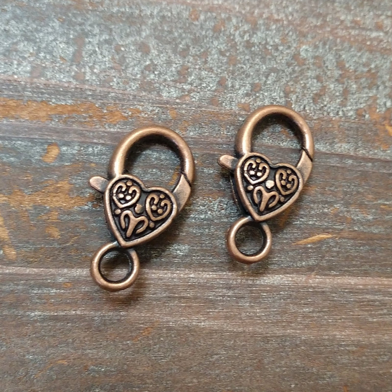 CL-9120 - Antique Copper Heart Lobster Clasp With Swirls, 14x26mm | Pkg 2