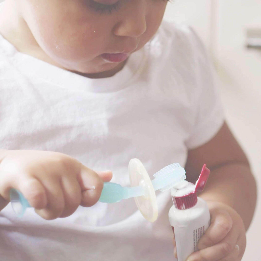 Toddler Using 360 Silicone Toothbrush