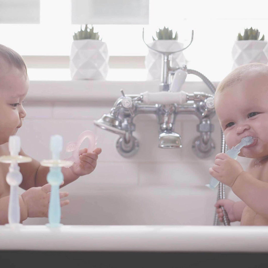 Two Babies Using 360 Silicone Toothbrush
