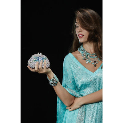 Model Wearing Bead Bracelet With Matching Aquamarine Necklace and Holding Butterfly Shape Clutch