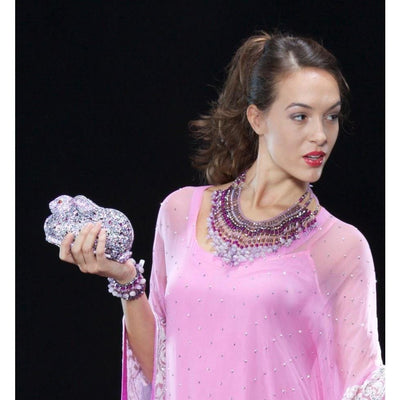 Woman Wearing Amethyst And Agate Beads Collar Necklace And Holding Rabbit Shaped Crystal Clutch Bag