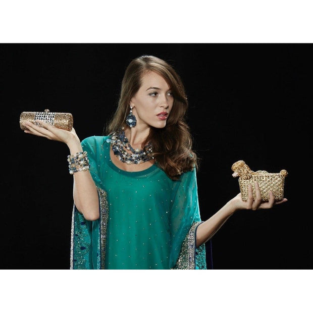 Woman Wearing Blue Lapis Lazuli And Baroque Pearls Necklace And Holding Gold Crystal Clutch Bags