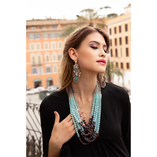 Woman Wearing Turquoise Chandelier Earrings And Turquoise Bead Necklace- GLAM CONFIDENTIAL