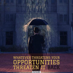 Man-standing_under-Umbrella_threats
