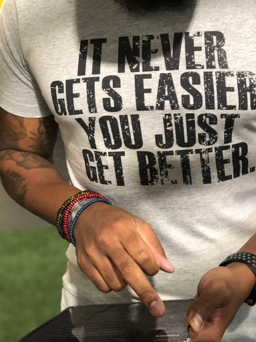 It Never Gets Easier You Just Get Better Slogan Tee