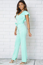 V-NECK RUFFLE TRIM SELF TIE BELT WIDE LEG PANT JUMPSUIT
