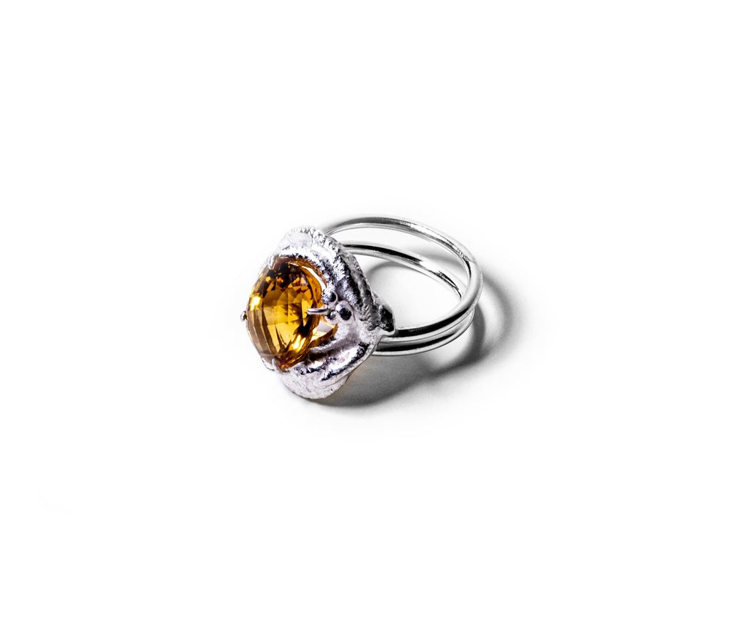 Sterling Silver Iso Checkered Citrine Ring. This Citrine measures at 14.75 x 11 mm. Side view depicting the melted sterling and brightness of Citrine. It is double banded, to prevent turning on the finger.
