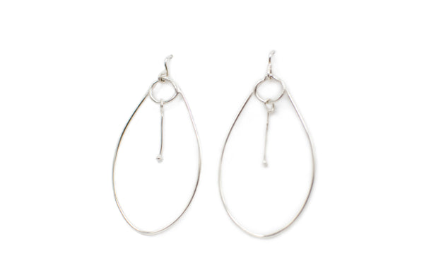 "Sterling Silver hoop earrings with moving drops in the center of hoop. Drops approximately 3"" from the ear. Hand sculpted and made with love in Savannah"