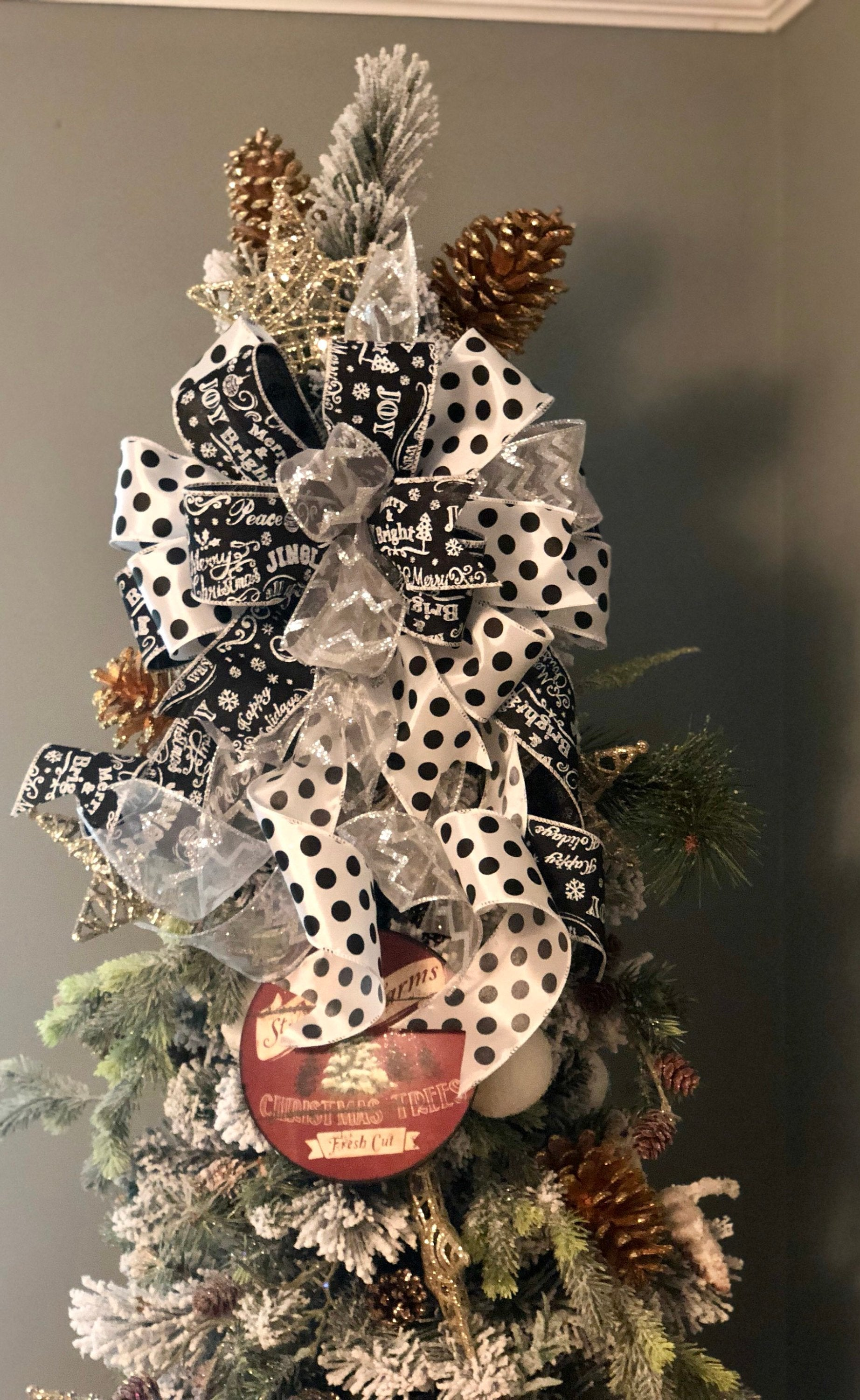 The Arianna Black White Silver Christmas Tree Topper Bow Crested Perch