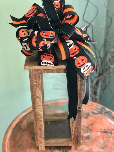 The Jack-o-lantern black white and orange Halloween bow for wreaths~pumpkin lantern bow~swag bow~mailbox bow~all hallows eve bow