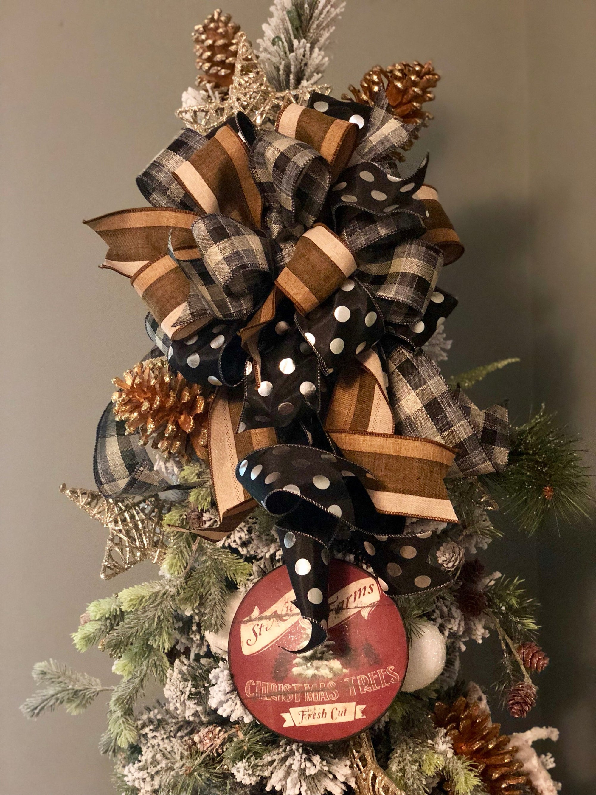 The Patrice Brown Black Farmhouse Christmas Tree Topper Bow Crested Perch