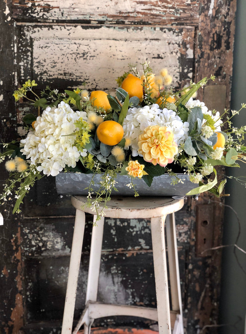 The Milagros Lemon & Hydrangea Farmhouse Centerpiece For Dining Table, yellow and cream Easter decor, spring cottage arrangement