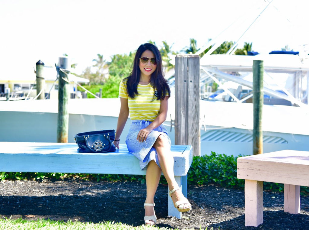 Woman sitting at the dock - Nautical Fashion - Petite Sizes Summer Trends