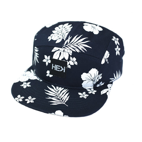 CURVED BRIM ISLAND TRUCKER HAT IN BLACK/WHITE