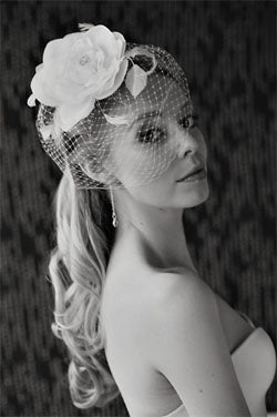 Large Silk and Organza Flower with Leaves and Feeler Feathers and Fly Away Birdcage Veil.