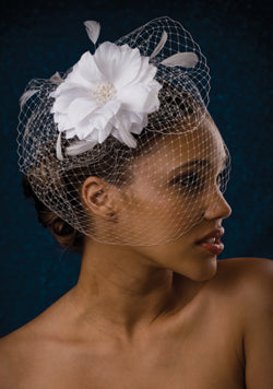 Fly Away Birdcage with Pouf Large flower with Pearl Stamens and stripped Coque Feathers.
