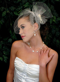 Basic Blusher Birdcage Veil with Birdcage pouf netting with hand beaded knotted and draped pearl accent.