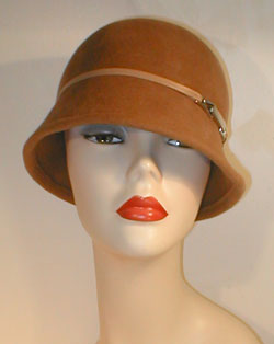 Velour Asymmetrical Cloche with Cream Lambskin Leather Band and Silver Accented Buckle.