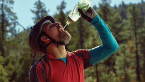 man drinking water to stay hydrated during workout