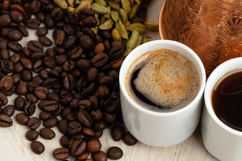 coffee beans and cups of coffee