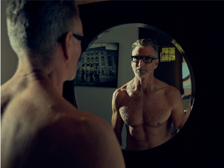 Man looking in mirror for motivation