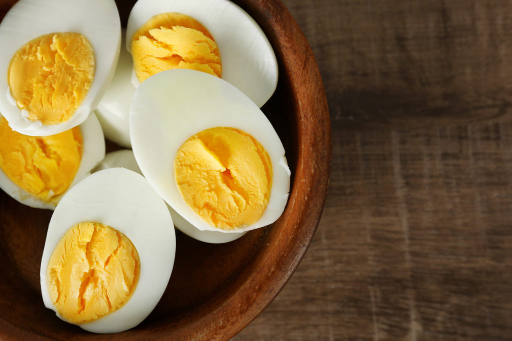 hardboiled eggs cut in half in a bowl
