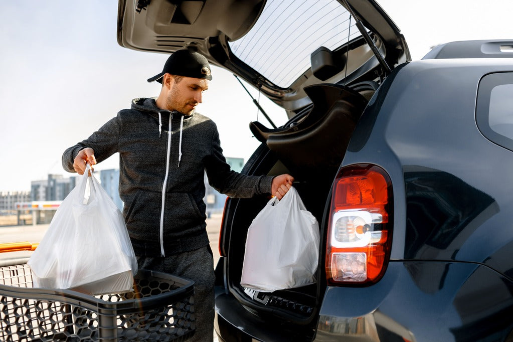 Man with groceries Avoid These Foods That Lower Testosterone