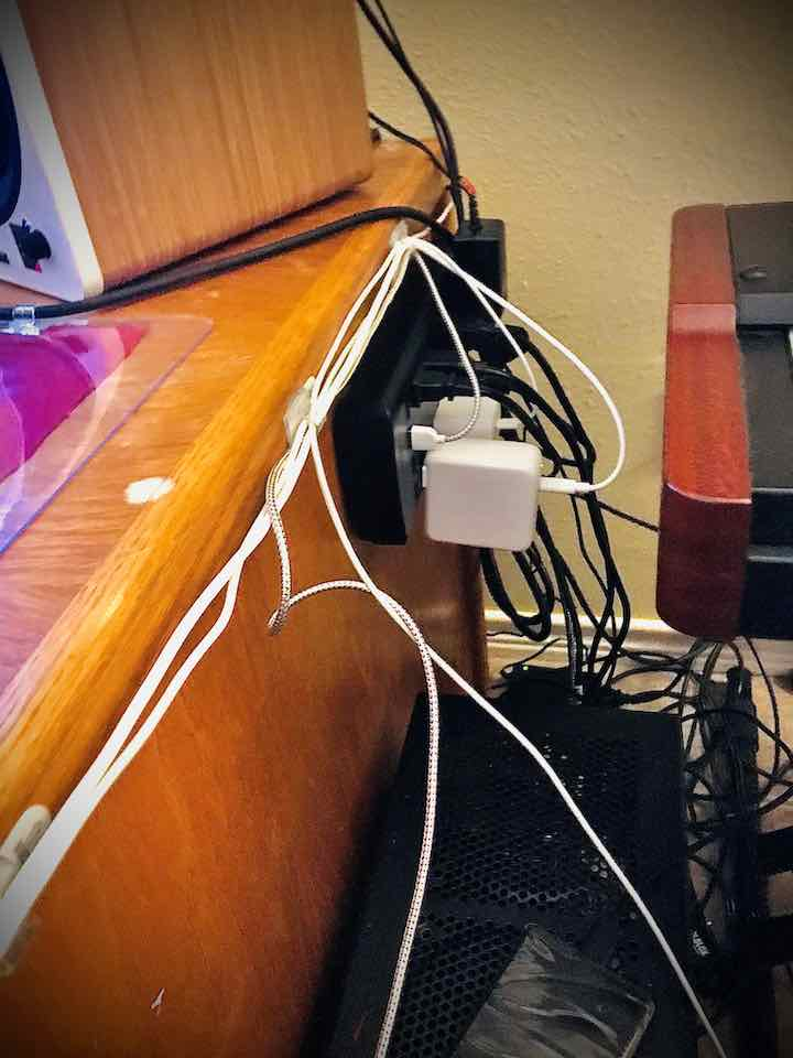 Power strip attached to side of desk with command strips