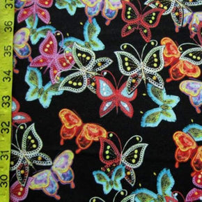Multicolour on Pale Grey Butterflies Cotton Jersey Fabric Cotton Lycra Stretch