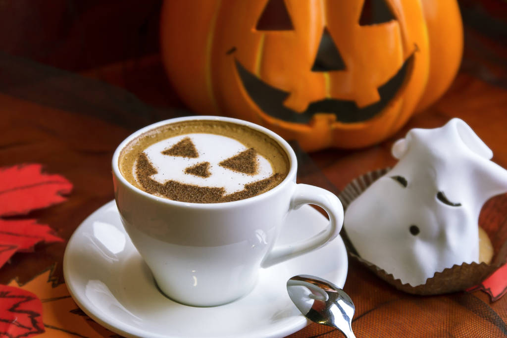 halloween coffee with jack-o-lantern and ghost cupcake