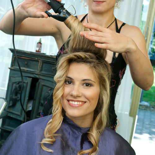 curling hair to add volume