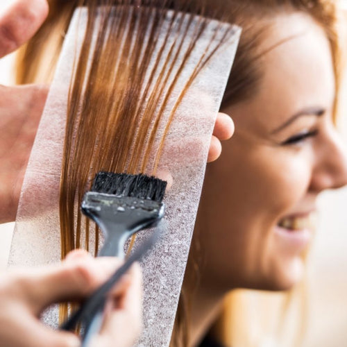 When should the brides hair be dyed before the wedding?