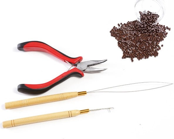 a pair of pliers, a threading tool and a few sectioning clips