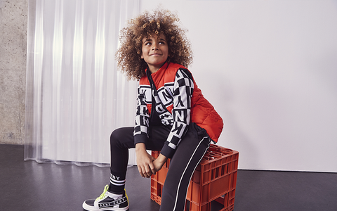 fashion kid with afro on stool urban outfit style