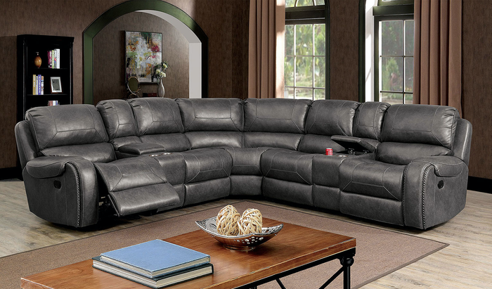 Jonanne Manual Sectional In Grey Leatherette