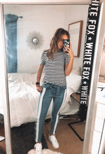 Load image into Gallery viewer, Trendy side stripe pants/jeans. Comfy and stretchy material and hits at the ankle with snaps at the bottom.
