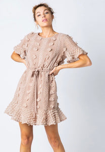 Unique, textured and so fun with the pom poms. This dress will capture anyone's attention. Perfect for date night, wedding guest, brunch and so much more! Wear it into the fall with booties and a jacket.