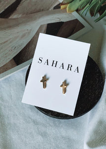 Gold cross studs will add a cute touch to any outfit!