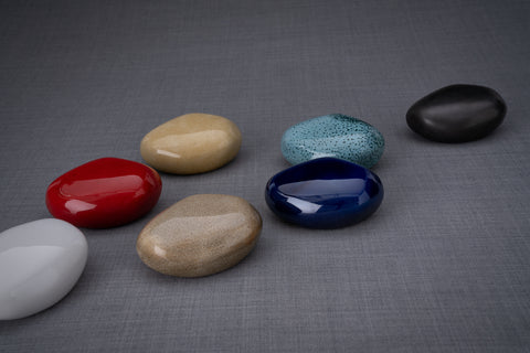 Various colours of keepsakes (model stone) by Pulvis Art Urns.