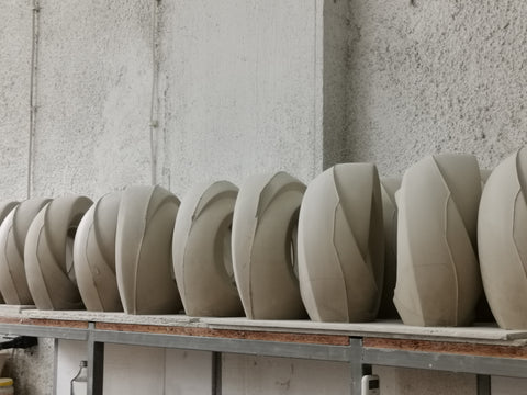 Clay shapes, ready to be fired by Pulvis Art Urns.