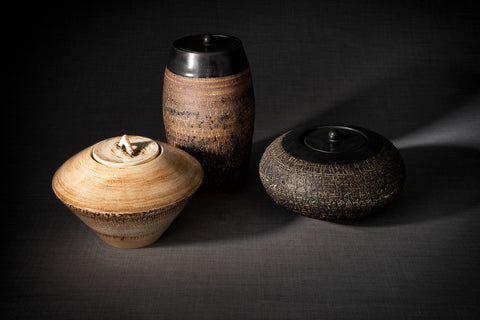Cremation urns for ashes made by pottery wheel. Pulvis Art Urns