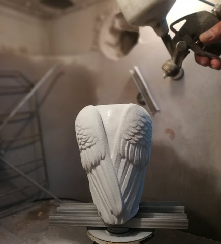 Glazing a ceramic urn for ashes. Photo by Pulvis Art Urns