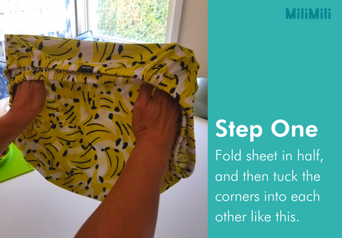 step one: fold the sheet in half, lengthwise, and tuck the corners into each other (as shown on MiliMili kona banana sheet)