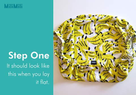 How to fold a crib sheet: step one - it should look like this when you lay it flat. Banana print cribsheet from MiliMili.