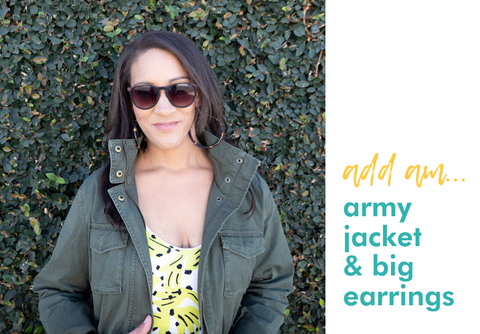 add an: army jacket and big earrings (image of milimili banana print sleep romper paired with army green jacket, sunglasses, and bamboo hoop earrings)